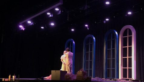 """Senior Henry Ravita, playing Jay Gatsby, and junior Alexis Weist, playing Daisy Buchanan, stand on stage. For their yearly One-Act the Starr's Mill drama department has chosen to perform """"The Great Gatsby."""" The play will be a retelling of events from F. Scott Fitzgerald's book, """"The Great Gatsby,"""" and will be performed in the region One-Act competition on October 23."""
